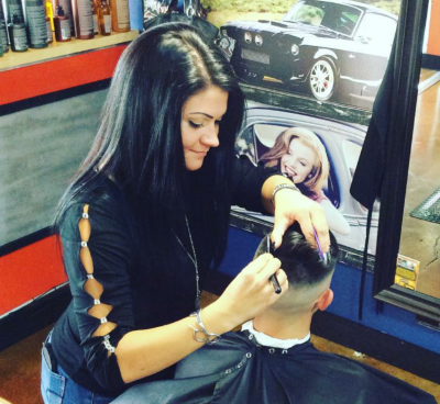 hairstylist doing fade haircut in southgate mi